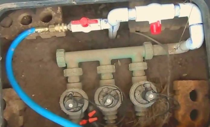 blowing out underground sprinkler line air compressor